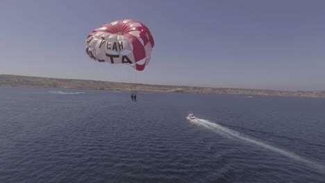 Good-Aerial-Over-A-Parasailing-Boat-On-The-Ocean-In-Malta