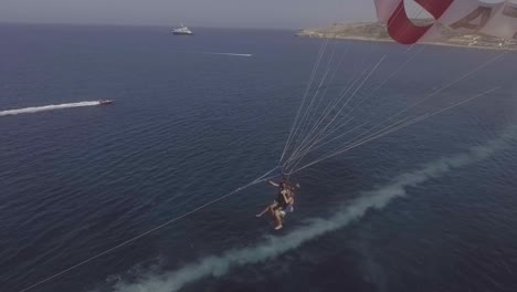 Good-Aerial-Over-A-Parasailing-Boat-On-The-Ocean-In-Malta-1