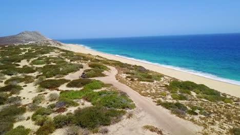 Nice-Aerial-Footage-Over-An-Atv-Speeding-Across-The-Sand-In-Cabo-San-Lucas-Baja-Mexico