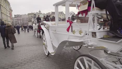 Horses-And-Carriages-Pass-On-The-Streets-Of-Krakow-Poland