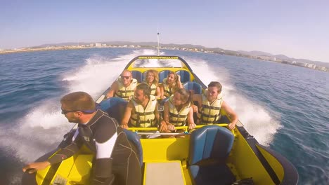 People-Take-A-High-Powered-Speedboat-Ride-On-The-Ocean-Near-Ibiza-Spain