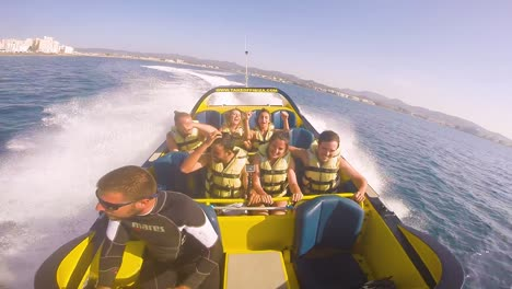 People-Take-A-High-Powered-Speedboat-Ride-On-The-Ocean-Near-Ibiza-Spain-1
