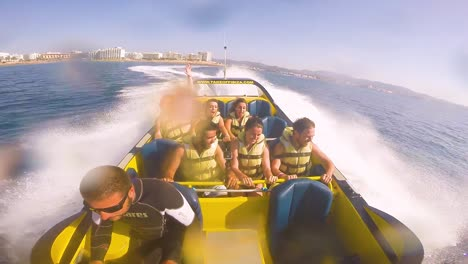 People-Take-A-High-Powered-Speedboat-Ride-On-The-Ocean-Near-Ibiza-Spain-2