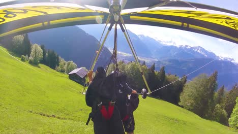 Nice-Gopro-Pov-Aerial-Shot-Of-A-Hang-Glider-Flying-Over-Switzerland-Alps-And-Villages-1