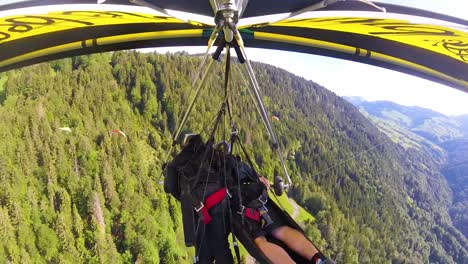 Nice-Gopro-Pov-Aerial-Shot-Of-A-Hang-Glider-Flying-Over-Switzerland-Alps-And-Villages-2