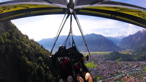 Nice-Gopro-Pov-Aerial-Shot-Of-A-Hang-Glider-Flying-Over-Switzerland-Alps-And-Villages-3