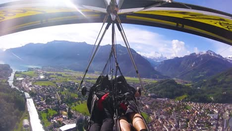 Nice-Gopro-Pov-Aerial-Shot-Of-A-Hang-Glider-Flying-Over-Switzerland-Alps-And-Villages-4