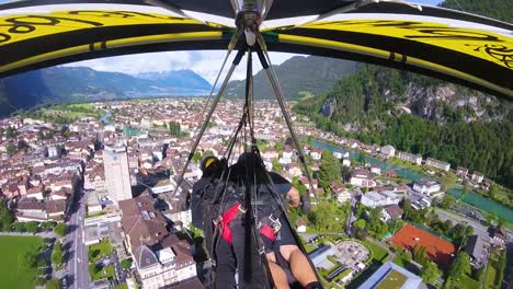 Nice-Gopro-Pov-Aerial-Shot-Of-A-Hang-Glider-Flying-Over-Switzerland-Alps-And-Villages-5