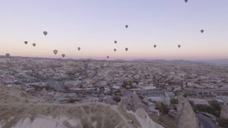 Good-Aerial-Rising-Shot-Of-Hot-Air-Balloons-Over-Cappadocia-Turkey