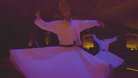 Whirling-Dervishes-Spin-In-A-Trance-In-A-Darkened-Mosque-In-Turkey