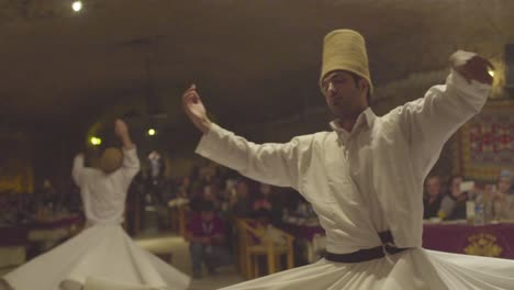 Whirling-Dervishes-Spin-In-A-Trance-In-A-Darkened-Mosque-In-Turkey-2