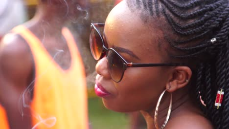 An-African-Woman-Dances-And-Smokes-In-Slow-Motion-At-A-Festival-In-Uganda