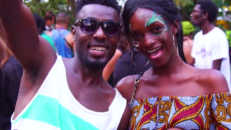 African-Man-And-Woman-With-Painted-Face-Party-And-Celebrate-At-A-Festival-In-Uganda