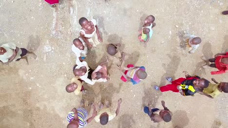 Aerial-Over-African-Children-Playing-And-Jumping-Up-And-Down