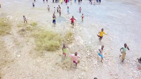 Aerial-Over-African-Children-Running-Playing-And-Jumping-Up-And-Down