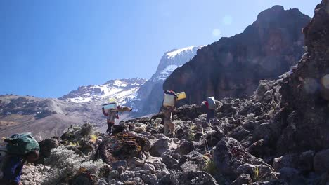 Hikers-porters-and-trekkers-walk-on-the-trail-to-the-summit-to-Mt-Kilimanjaro-Tanzania-Africa