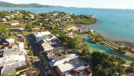 An-aerial-view-shows-Airlie-Beach-and-its-surrounding-homes-and-roads