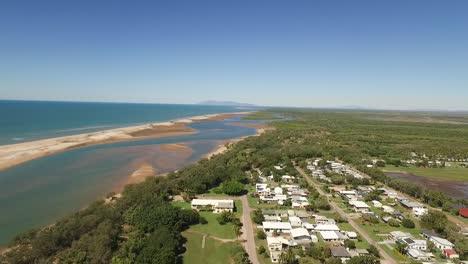 An-aerial-view-shows-housing-near-a-beach-in-the-town-of-Alva-in-Queensland-Australia