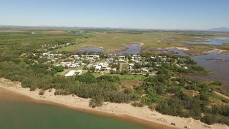 An-aerial-view-shows-a-neighborhood-in-the-coastal-town-of-Alva-in-Queensland-Australia