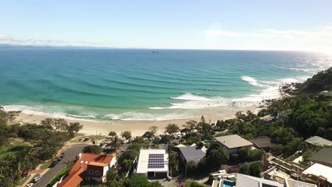 An-aerial-view-shows-waves-cresting-on-the-shore-of-Byron-Bay-in-New-South-Wales-Australia