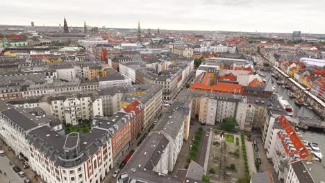 An-aerial-view-shows-the-cityscape-bordering-the-Nyhavn-canal-in-Copenhagen-Denmark