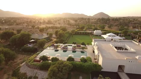 An-aerial-view-shows-tourists-enjoying-a-swimming-pool-at-the-Alila-Fort-Bishangarh-in-Jaipur-Rajasthan-India