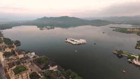 An-aerial-view-shows-the-Taj-Lake-Palace-on-Lake-Pichola-in-Udaipur-India-is-seen