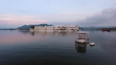 Boats-are-seen-by-the-Taj-Lake-Palace-on-Lake-Pichola-in-Udaipur-India