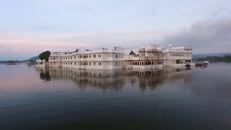 The-Taj-Lake-Palace-on-Lake-Pichola-in-Udaipur-India-is-seen-at-sunset-1