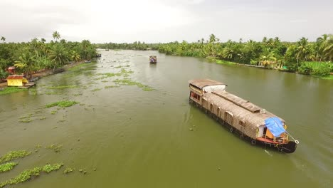 A-houseboat-is-seen-sailing-down-a-river-in-Kerala-India
