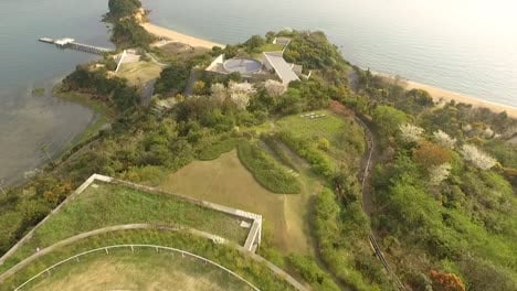 An-aerial-view-shows-the-Benesse-House-and-the-coastline-of-Naoshima-Island-in-Japan