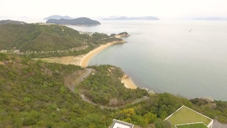 An-aerial-view-shows-the-Chichu-Art-Museum-and-the-coastline-of-Naoshima-Island-in-Japan