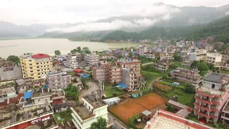 An-aerial-view-shows-the-mountains-and-the-city-of-Pokhara-Nepal-on-Phewa-Lake