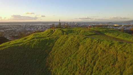 An-aerial-view-shows-tourists-visiting-Maungawhau-the-volcanic-peak-of-Mount-Eden-in-Auckland-New-Zealand-2