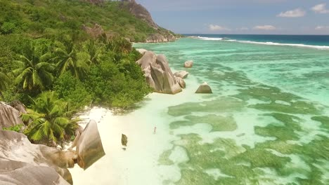 An-aerial-view-shows-tourists-enjoying-the-beach-on-the-La-Digue-Island-in-the-Seychelles