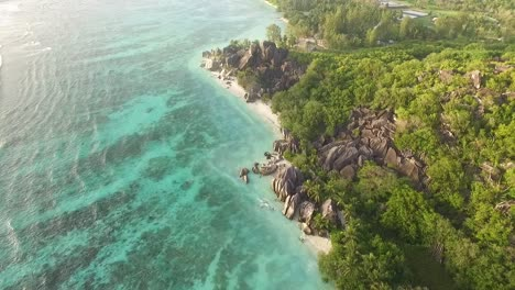 An-aerial-view-shows-gentle-waves-rippling-towards-La-Digue-island-in-the-Seychelles