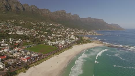 An-aerial-view-shows-waves-cresting-on-the-shore-of-Camps-Bay-in-Cape-Town-South-Africa