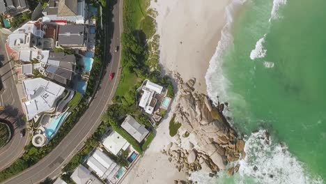 A-bird-seyeview-shows-cars-driving-by-the-beach-of-Camps-Bay-in-Cape-Town-South-Africa-1