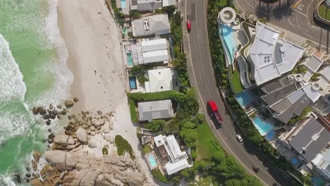 A-bird-seyeview-shows-cars-driving-by-the-beach-of-Camps-Bay-in-Cape-Town-South-Africa-2