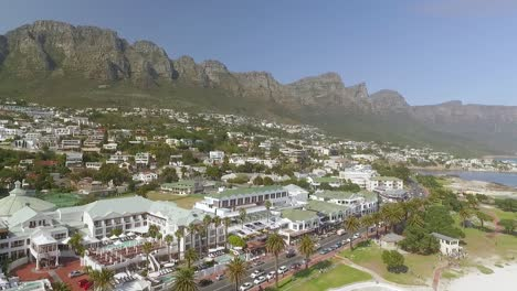 An-aerial-view-shows-beaches-and-mountains-of-Camps-Bay-in-Cape-Town-South-Africa