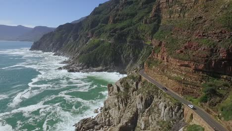Cars-are-seen-driving-by-the-seaside-along-Chapman-s-Peak-in-South-Africa