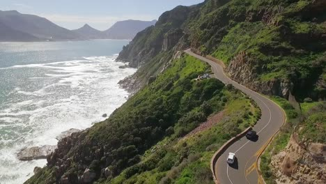 An-aerial-view-shows-cars-are-seen-driving-by-the-seaside-along-Chapman-s-Peak-in-South-Africa-1