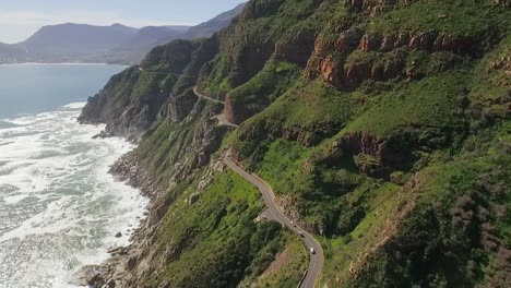 An-aerial-view-shows-cars-are-seen-driving-by-the-seaside-along-Chapman-s-Peak-in-South-Africa-2