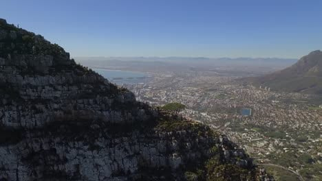 An-aerial-view-shows-the-city-behind-the-Lion-s-Head-mountain-in-Cape-Town-South-Africa