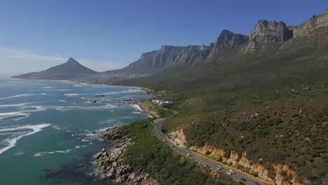 An-aerial-view-shows-cars-driving-along-the-seaside-resort-of-Oudekraal-in-Cape-Town-South-Africa