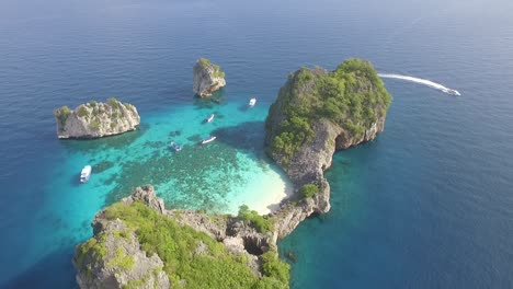 An-aerial-view-shows-boats-by-the-Koh-Haa-islands-of-Thailand