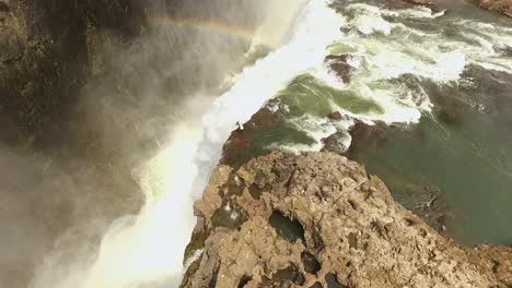 An-aerial-view-shows-a-tourist-atop-Victoria-Falls-at-the-Devil-s-Pool-in-Zambia