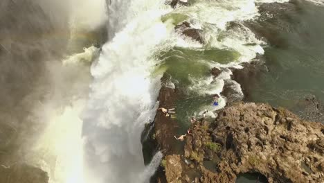 An-aerial-view-shows-tourists-swimming-atop-Victoria-Falls-at-the-Devil-s-Pool-in-Zambia