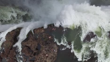 A-bird\-seyeview-shows-tourists-swimming-atop-Victoria-Falls-at-the-Devil\-s-Pool-in-Zambia
