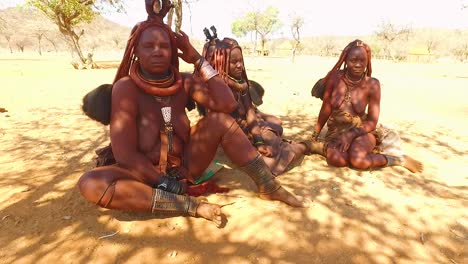 Himba-tribal-women-show-off-their-mud-hair-extensions-and-unusual-braided-dreadlocked-hairstyles